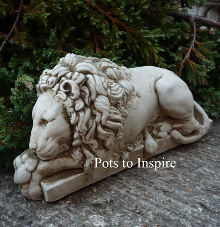 Small laying down lion animal garden ornament woodside garden please call 01268 747888 for delivery cost to postcodes pa20phddabivkw workwithnaturefo